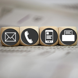Picture wooden dice: envelop, telephone receive, mobile phone, fax